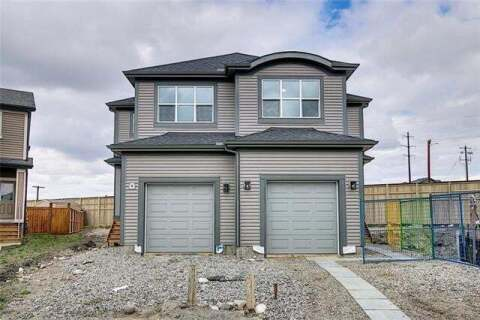 Townhouse for sale at 332 Quigley Dr Cochrane Alberta - MLS: C4297886