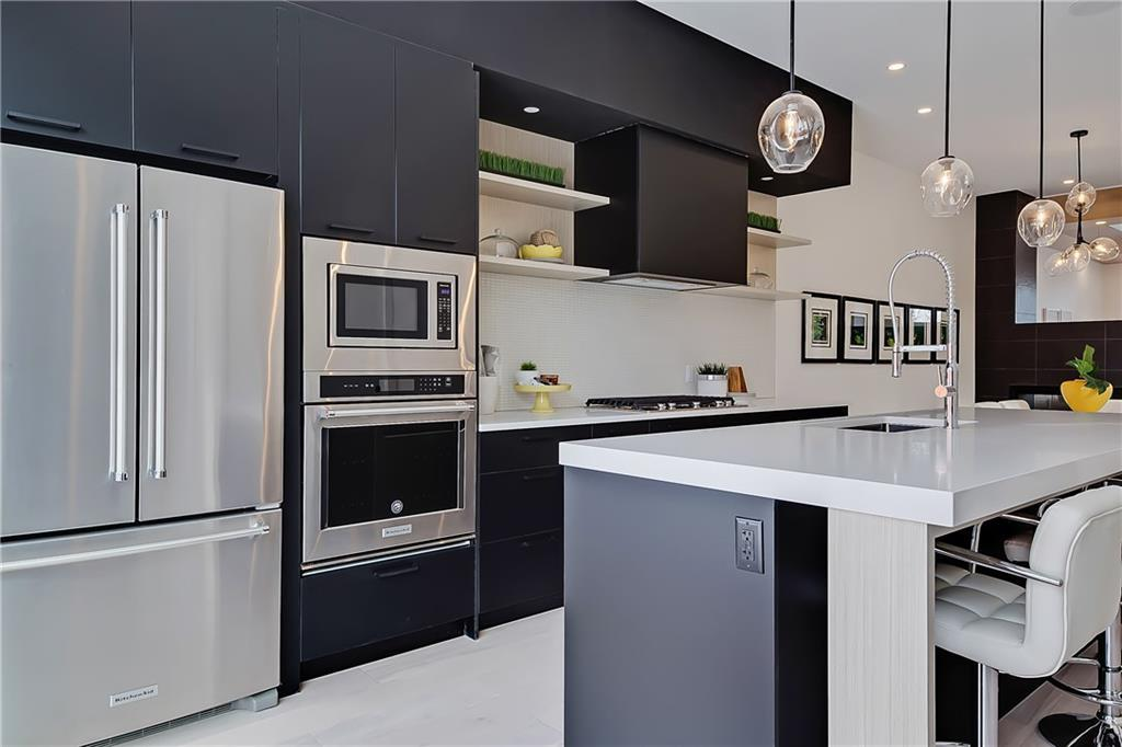 For Sale: 3331 40 Street Southwest, Calgary, AB | 4 Bed, 3 Bath Townhouse for $769,990. See 50 photos!