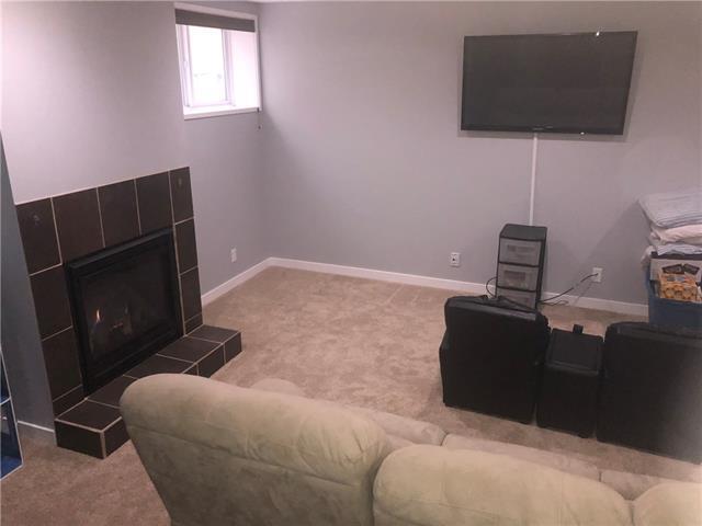 For Sale: 338 Cimarron Boulevard, Okotoks, AB | 4 Bed, 3 Bath House for $399,900. See 27 photos!