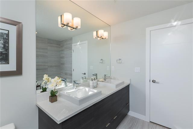 For Sale: 3415 - 95 Burma Star Road Southwest, Calgary, AB | 2 Bed, 2 Bath Condo for $725,000. See 26 photos!