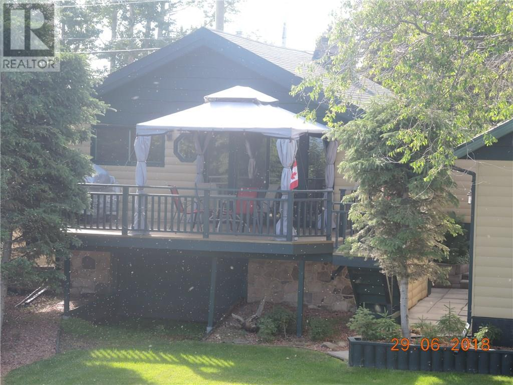 For Sale: 3415 Lakeshore Drive, Sylvan Lake, AB | 2 Bed, 2 Bath Home for $645,000. See 30 photos!