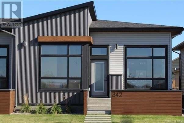 Townhouse for sale at 348 Uplands Blvd N Lethbridge Alberta - MLS: ld0193618