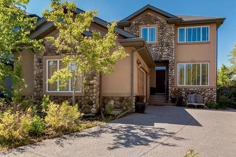 House for sale at 35 Rockcliff Landng Northwest Calgary Alberta - MLS: C4255515