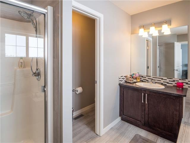 For Sale: 354 Reunion Green Northwest, Airdrie, AB   3 Bed, 2 Bath House for $497,900. See 30 photos!