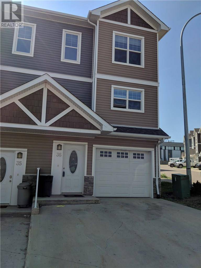 Townhouse for sale at 180 Riverstone Rdge Unit 36 Fort Mcmurray Alberta - MLS: fm0186504