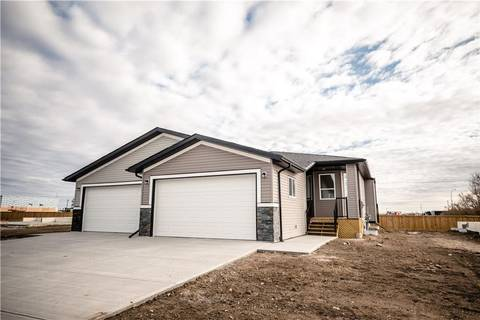 Townhouse for sale at 38 Harvest Sq Claresholm Alberta - MLS: C4208401