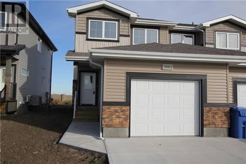 Townhouse for sale at 3862 Gee Cres Regina Saskatchewan - MLS: SK765869