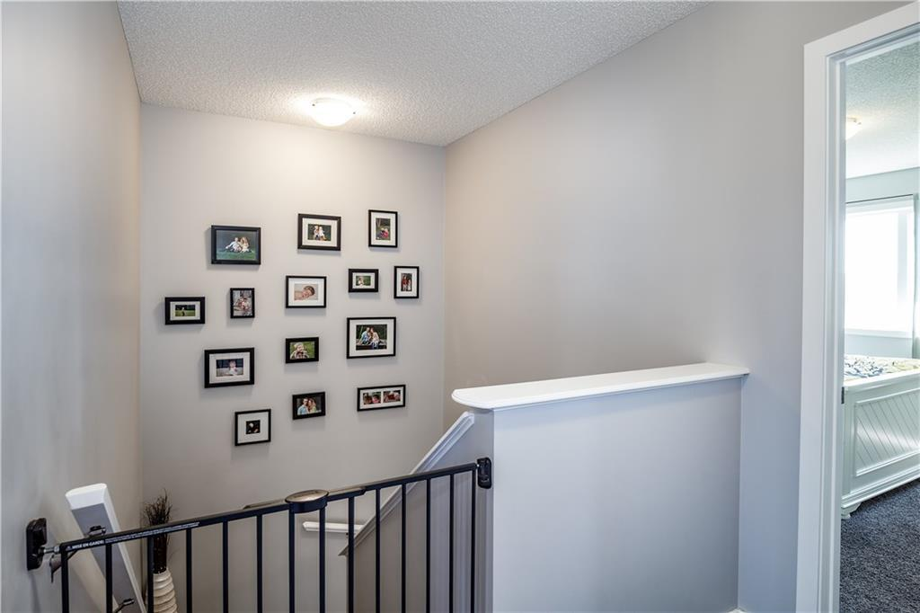 For Sale: 394 River Heights Crescent, Cochrane, AB | 3 Bed, 2 Bath Townhouse for $359,900. See 32 photos!