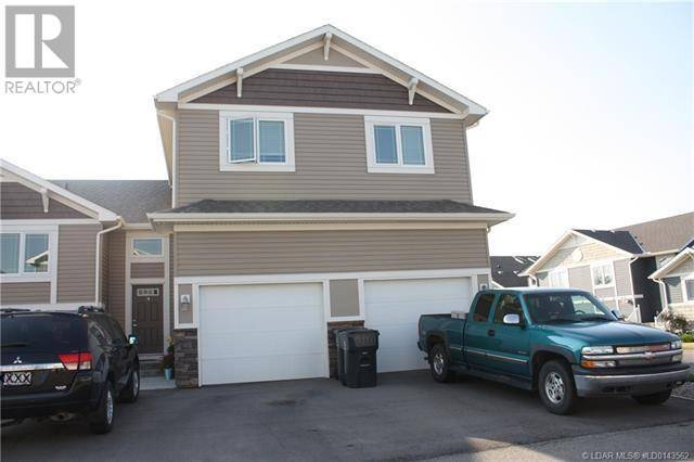 Townhouse for sale at 215 Lettice Perry Rd N Unit 4 Lethbridge Alberta - MLS: ld0191157