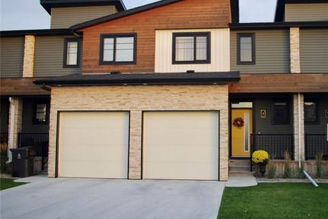 Townhouse for sale at 434 Highlands Blvd W Unit 4 Lethbridge Alberta - MLS: LD0179870
