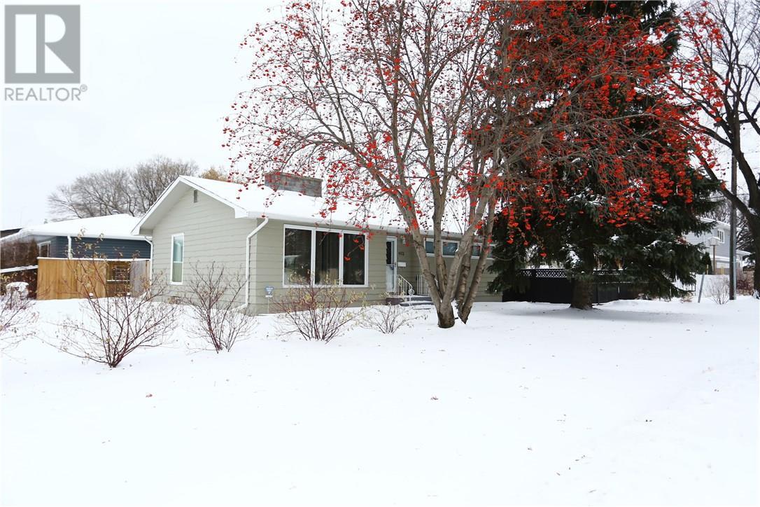 For Sale: 402 Elm St E, Saskatoon, SK | 4 Bed, 3 Bath House for $339,900. See 37 photos!
