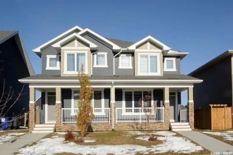 Townhouse for sale at 4042 Centennial Dr Saskatoon Saskatchewan - MLS: SK798907