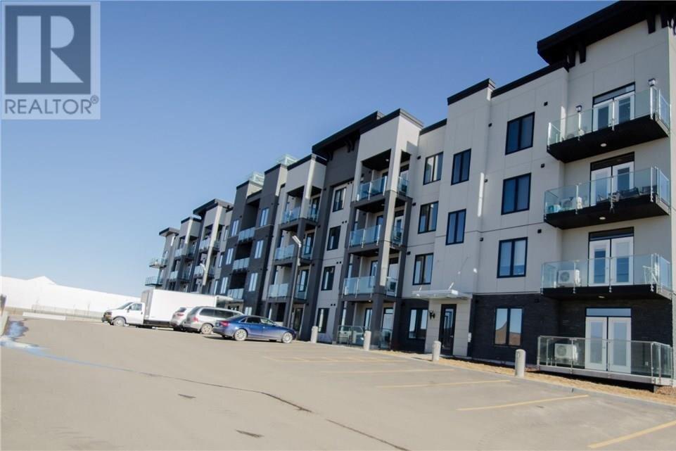 Condo for sale at 2165 Heseltine Rd Unit 410 Regina Saskatchewan - MLS: SK808658