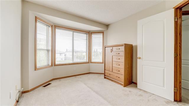 For Sale: 42 Saratoga Close Northeast, Calgary, AB | 4 Bed, 2 Bath House for $359,900. See 18 photos!