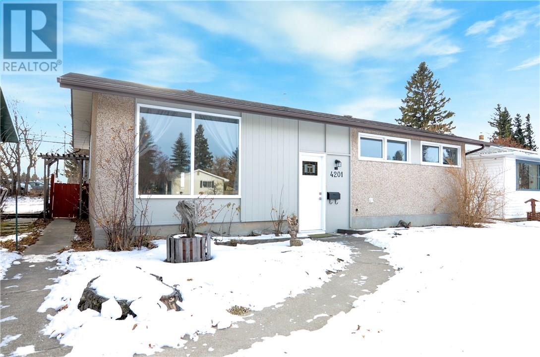 For Sale: 4201 - 33 Street , Red Deer, AB | 5 Bed, 2 Bath House for $339,900. See 24 photos!