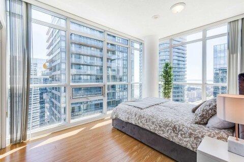 Apartment for rent at 65 Bremner Blvd Unit 4202 Toronto Ontario - MLS: C5003596