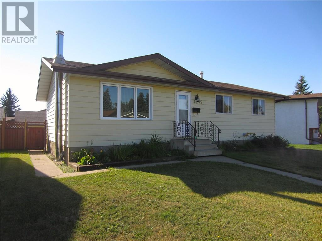 For Sale: 4215 - 75 Street , Camrose, AB | 4 Bed, 2 Bath House for $239,000. See 22 photos!
