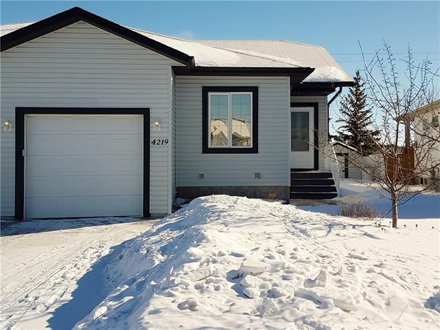 For Sale: 4219 51 Avenue, Olds, AB | 3 Bed, 3 Bath Townhouse for $264,900. See 5 photos!