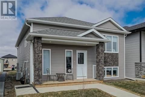 House for sale at 423 Ells Wy Saskatoon Saskatchewan - MLS: SK766342