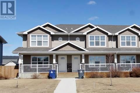 Townhouse for sale at 424 Maningas Bnd  Saskatoon Saskatchewan - MLS: SK762753