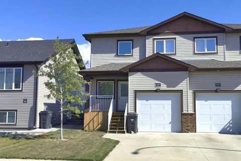 Townhouse for sale at 4407 Lake Dr Coalhurst Alberta - MLS: LD0180531