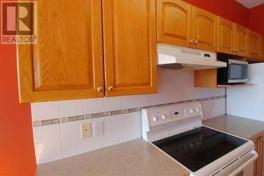 Condo for sale at 4500 50 Ave Olds Alberta - MLS: CA0185234
