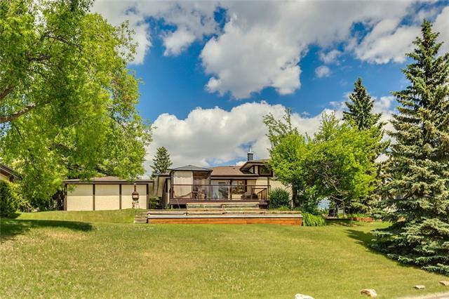 For Sale: 4511 Grove Hill Road Southwest, Calgary, AB | 5 Bed, 3 Bath House for $925,000. See 24 photos!