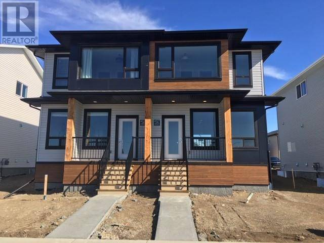 Townhouse for sale at 4525 Fairmont Gt S Lethbridge Alberta - MLS: ld0188064