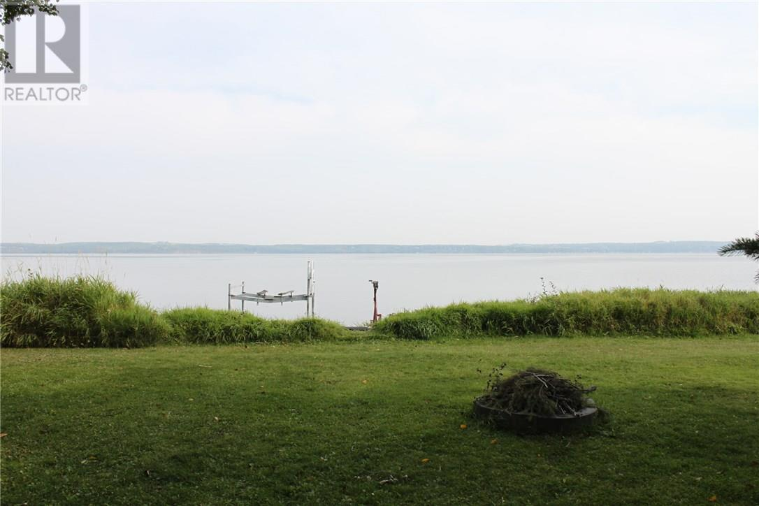 For Sale: 49 Lakeview Road, Sylvan Lake, AB | 3 Bed, 2 Bath House for $869,900. See 17 photos!