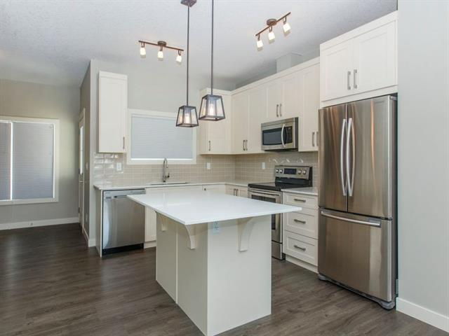 For Sale: 504 Cranford Drive Southeast, Calgary, AB | 3 Bed, 3 Bath Townhouse for $369,800. See 20 photos!