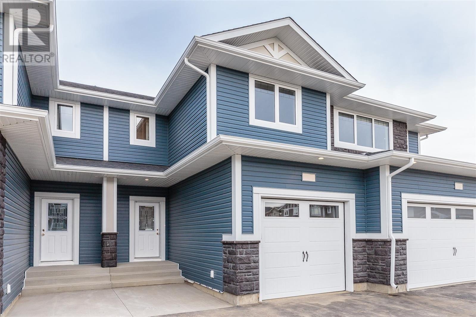 Townhouse for sale at 115 Veltkamp Cres Unit 52 Saskatoon Saskatchewan - MLS: SK808873