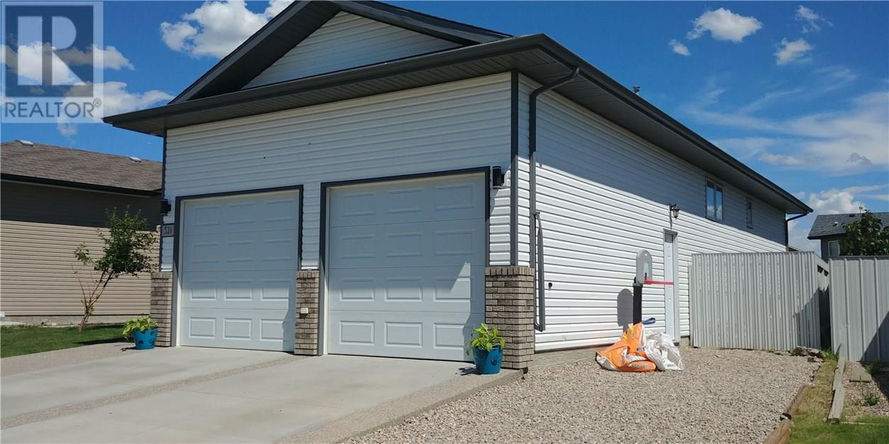 For Sale: 521 5 Avenue Southwest, Redcliff, AB | 4 Bed, 3 Bath House for $369,900. See 25 photos!
