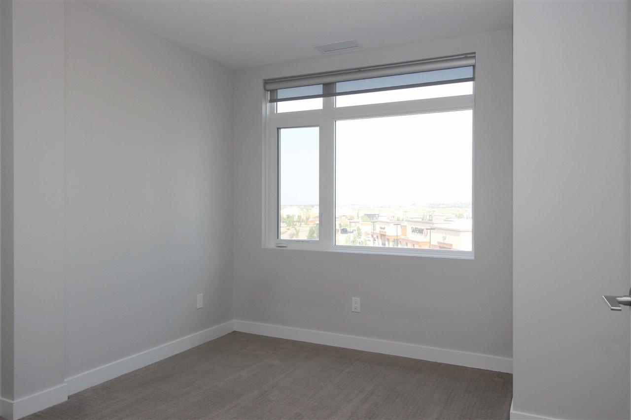 For Sale: 531 - 5151 Windermere Boulevard, Edmonton, AB | 2 Bed, 2 Bath Condo for $299,800. See 27 photos!