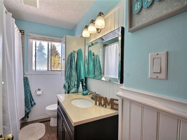For Sale: 5311 97a Avenue, Edmonton, AB | 5 Bed, 2 Bath House for $460,000. See 14 photos!
