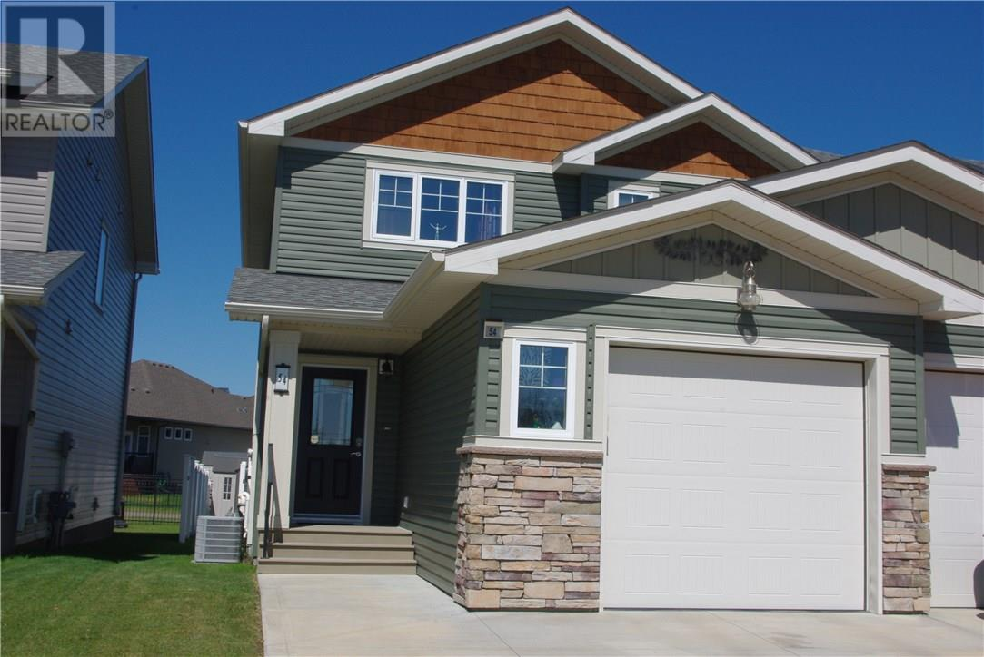 For Sale: 54 Van Slyke Way, Red Deer, AB | 4 Bed, 4 Bath Townhouse for $340,000. See 21 photos!