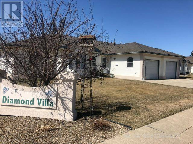 Townhouse for sale at 5404 49th Ave Lloydminster East Saskatchewan - MLS: 65613