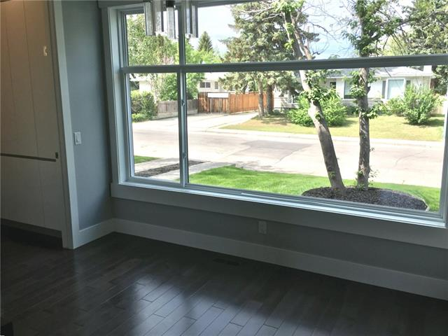 For Sale: 55 Rossdale Road Southwest, Calgary, AB   4 Bed, 3 Bath Townhouse for $699,990. See 35 photos!