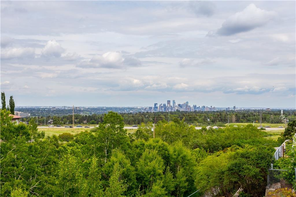 For Sale: 5648 Coach Hill Road Southwest, Calgary, AB   4 Bed, 2 Bath House for $664,500. See 47 photos!