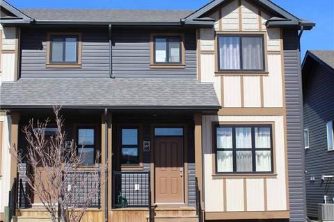 Townhouse for sale at 567 Blackwolf Blvd N Lethbridge Alberta - MLS: LD0158495