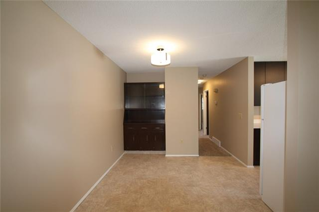 For Sale: 571 Macewan Drive Northwest, Calgary, AB | 3 Bed, 1 Bath Townhouse for $288,800. See 17 photos!