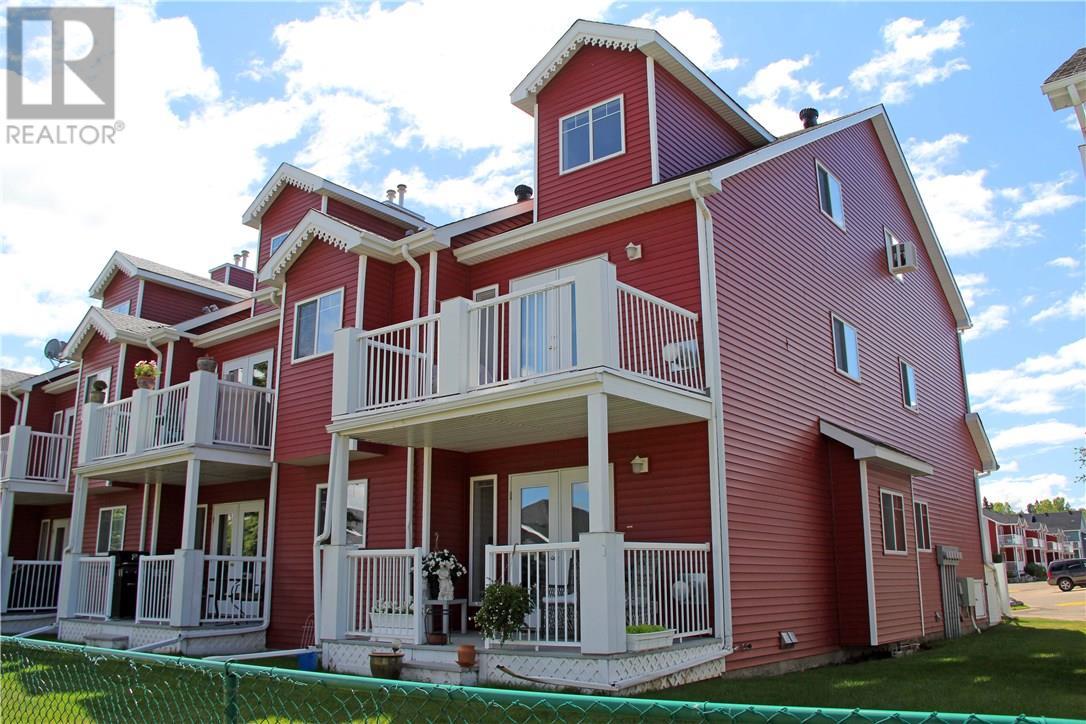 Buliding: 5220 50a Avenue, Sylvan Lake, AB