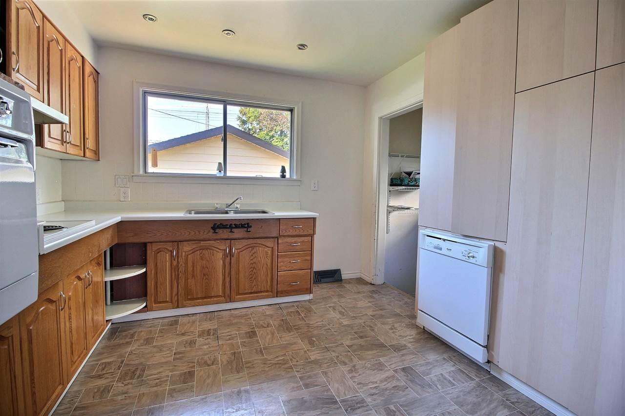 For Sale: 6012 101a Avenue, Edmonton, AB | 3 Bed, 2 Bath House for $369,900. See 10 photos!
