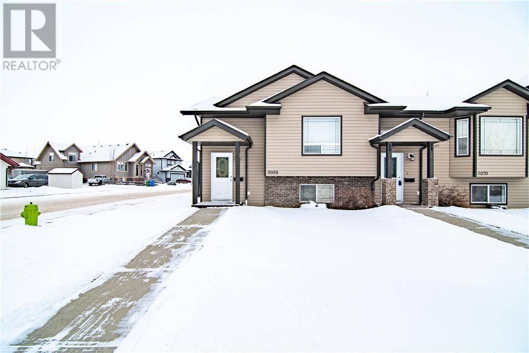 Townhouse for sale at 6068 Orr Dr Red Deer Alberta - MLS: ca0185867