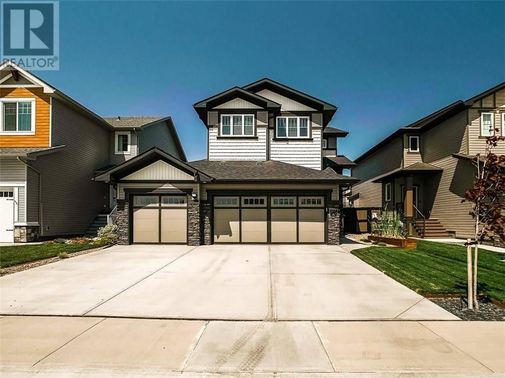 House for sale at 617 Aquitania Blvd W Lethbridge Alberta - MLS: ld0189753