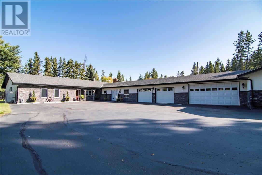 For Sale: 6194 Cronquist Drive, Red Deer, AB | 3 Bed, 3 Bath House for $1,100,000. See 29 photos!