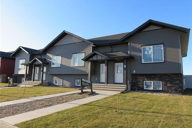 Townhouse for sale at 62667074 Mackenzie Ranch Wy Lacombe Alberta - MLS: CA0180373