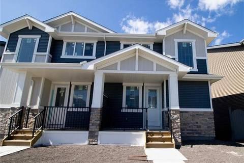 Townhouse for sale at 63 Sunrise Wy Cochrane Alberta - MLS: C4263915