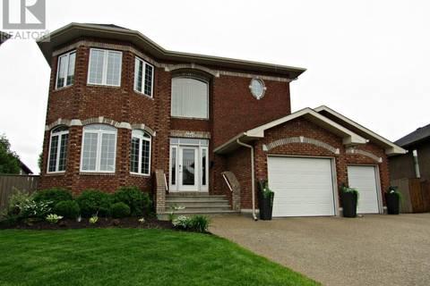 House for sale at 6443 Wascana Court By Regina Saskatchewan - MLS: SK766006
