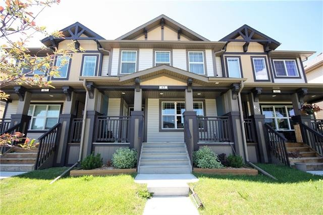 For Sale: 65 Belgian Street, Cochrane, AB | 3 Bed, 2 Bath Townhouse for $319,900. See 18 photos!