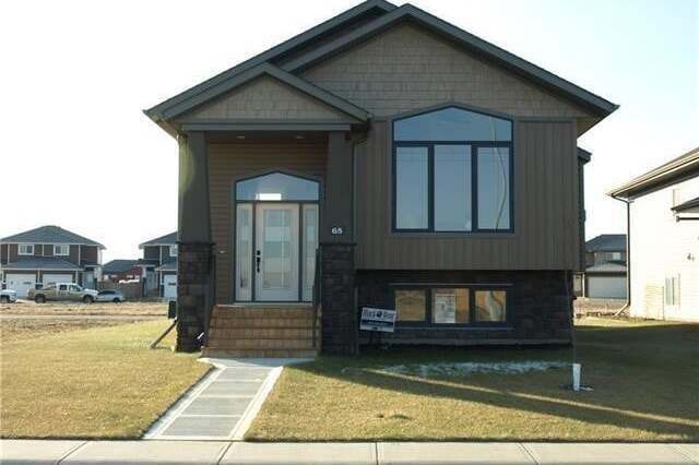 House for sale at 65 Mackenzie Ave Lacombe Alberta - MLS: CA0183041